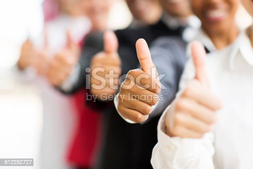 istock business people giving thumbs up 512252727