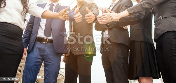 istock Business people Giving Thumbs up show thumb 891531352