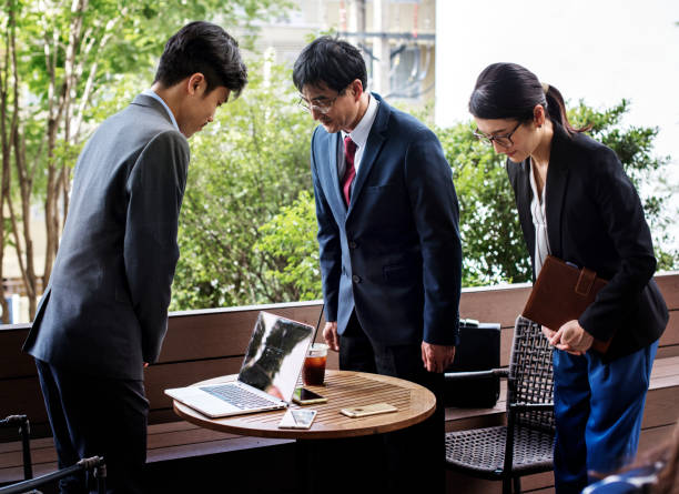 Business people greeting bowing gesture stock photo