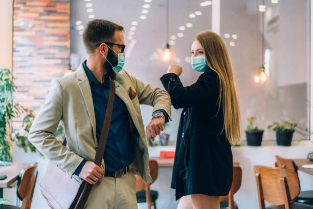 Business people greeting during COVID-19 pandemic stock photo