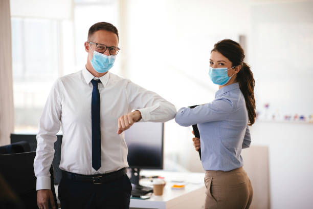 Business people greeting during COVID-19 pandemic stock photo stock photo
