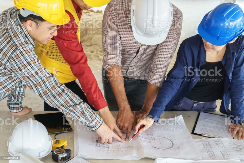 Business people group on meeting and presentation with construction business people group on meeting and presentation with construction engineer architect looking building model and blueprint malvernweather Images