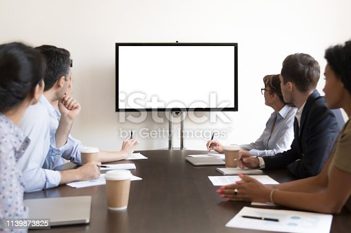 istock Business people group sitting at conference table looking at screen 1139873825