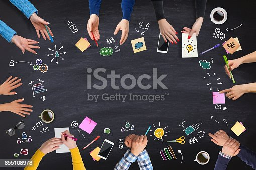 istock Business people group works at a blackboard table 655108978
