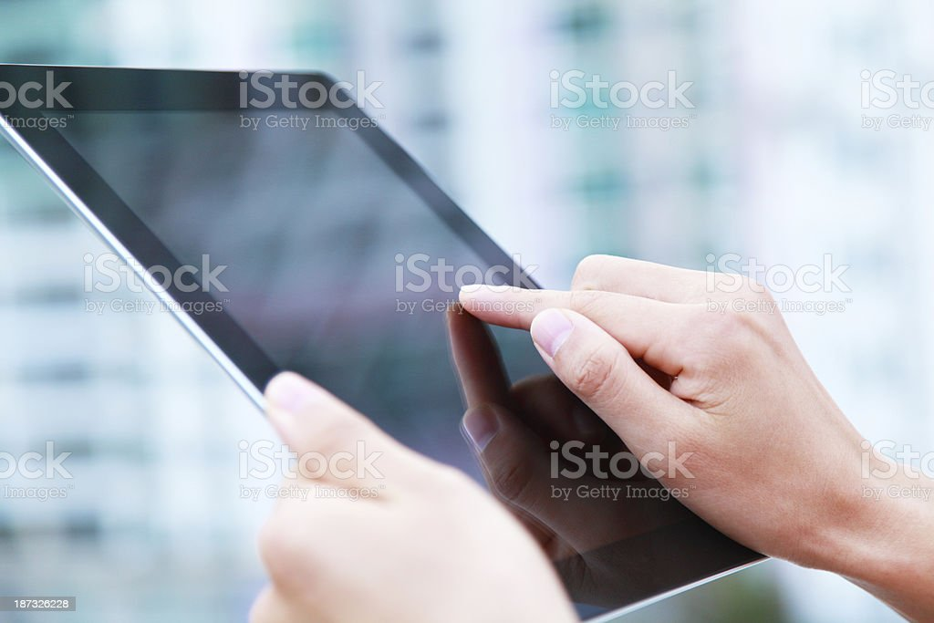 Business people hand holding digital tablet on light blue background stock photo