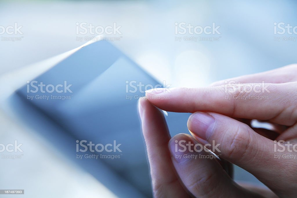 Business people hand holding digital tablet on light blue background royalty-free stock photo