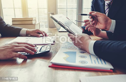 istock Business people hand pointing at business document during discussion at meeting. 1148791823
