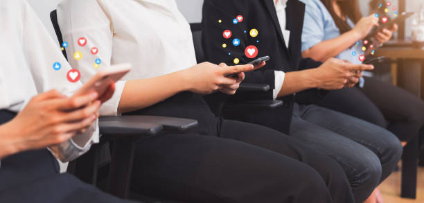 Business people hand using smartphone and show icon social media. Network technology concept. stock photo