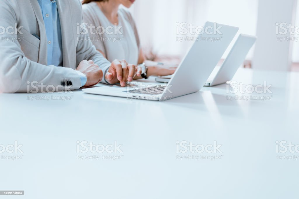 Business people, hands and computers stock photo