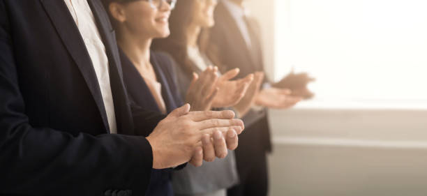 business people hands applauding at meeting - applaudire foto e immagini stock