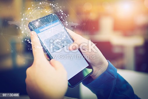 istock Business people hands holding smartphone with smart connection technology icons. Online business or E-commerce. 931130466