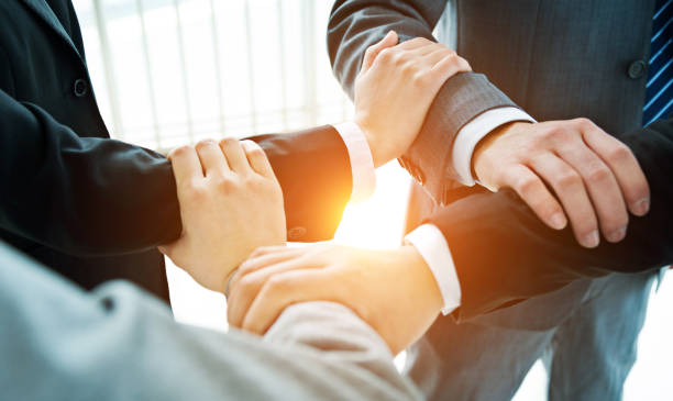 Business people hands locked stock photo