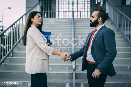 Business people handshaking and making a deal