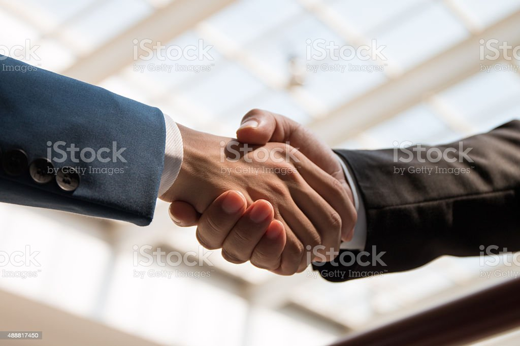 business people handshaking stock photo