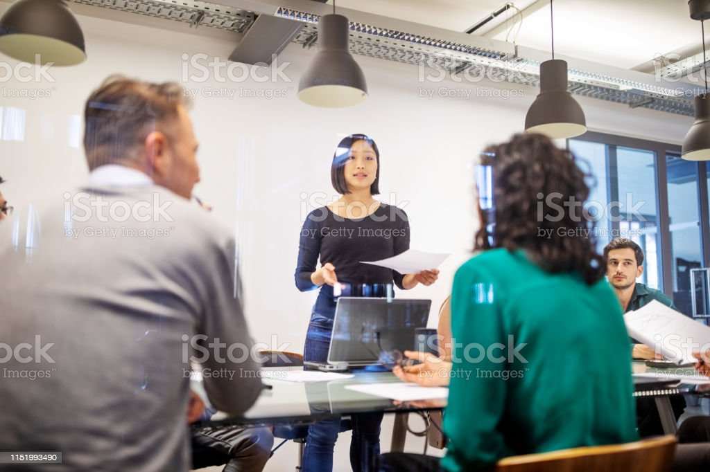 Business people having a brainstorming meeting in board room - Royalty-free Adult Stock Photo