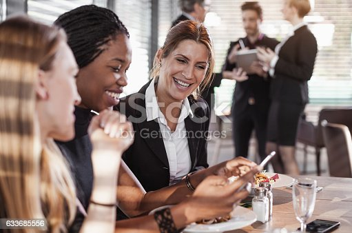 istock Business People Having a Meal at a Cafe Restaurant 633685556