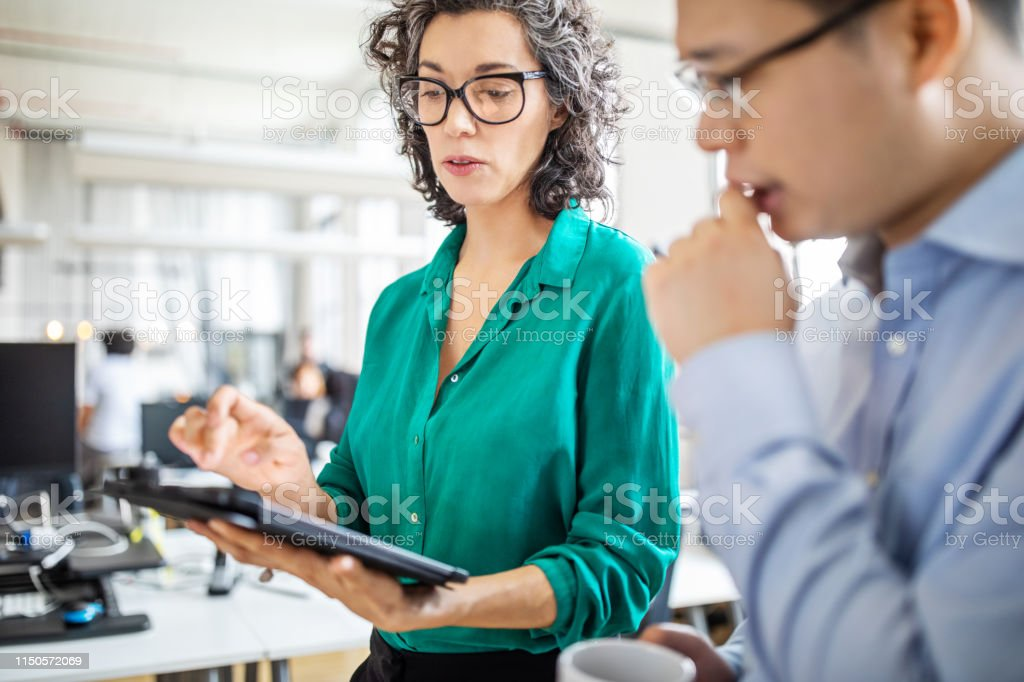 Business people having a meeting in office - Royalty-free Adult Stock Photo