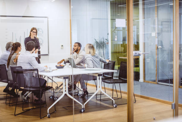 Business People Having a Meeting in The Board Room Business People Having a Meeting in The Board Room staff meeting stock pictures, royalty-free photos & images