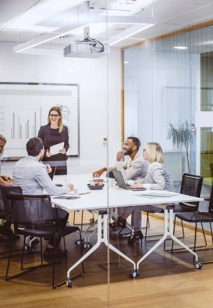 Business People Having a Meeting in The Board Room stock photo