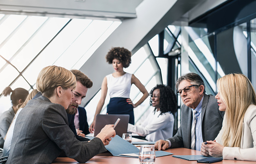 672116416 istock photo Business People Having a Meeting in the Board Room 648879812