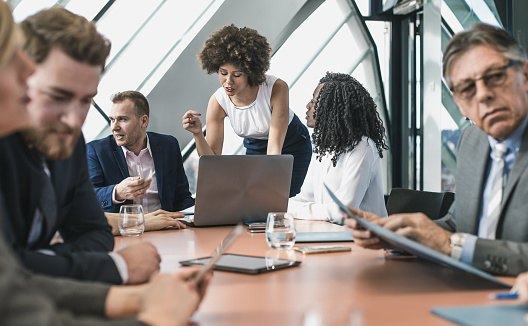 672116416 istock photo Business People Having a Meeting in the Board Room 648879840