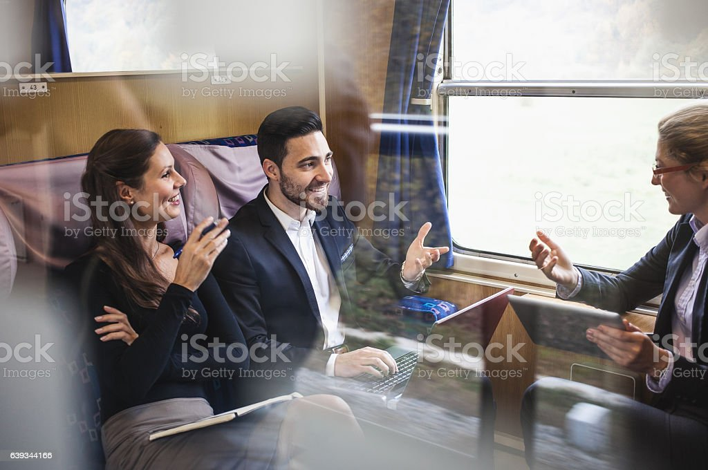 Business People Having a Meeting on a Train stock photo