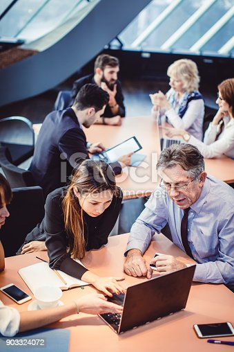 672116416istockphoto Business People Having a Meeting 903324072