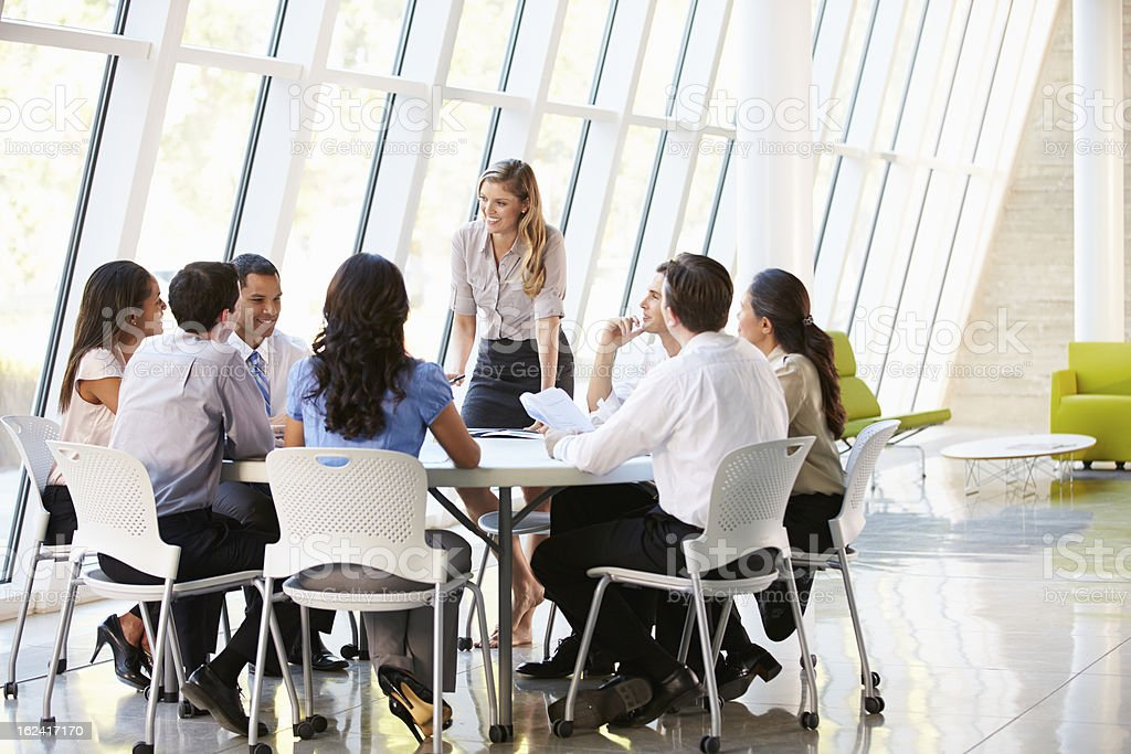 Business People Having Board Meeting In Modern Office royalty-free stock photo