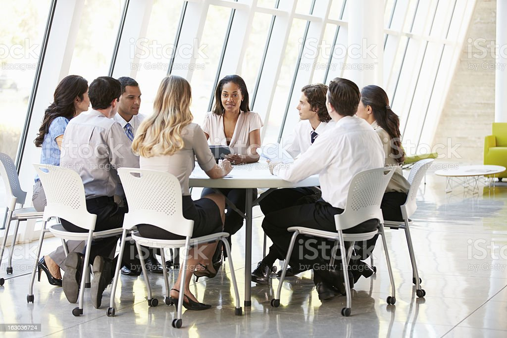 Business People Having Board Meeting In Office royalty-free stock photo