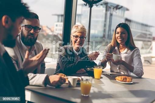 istock Business people having breakfast 959928982