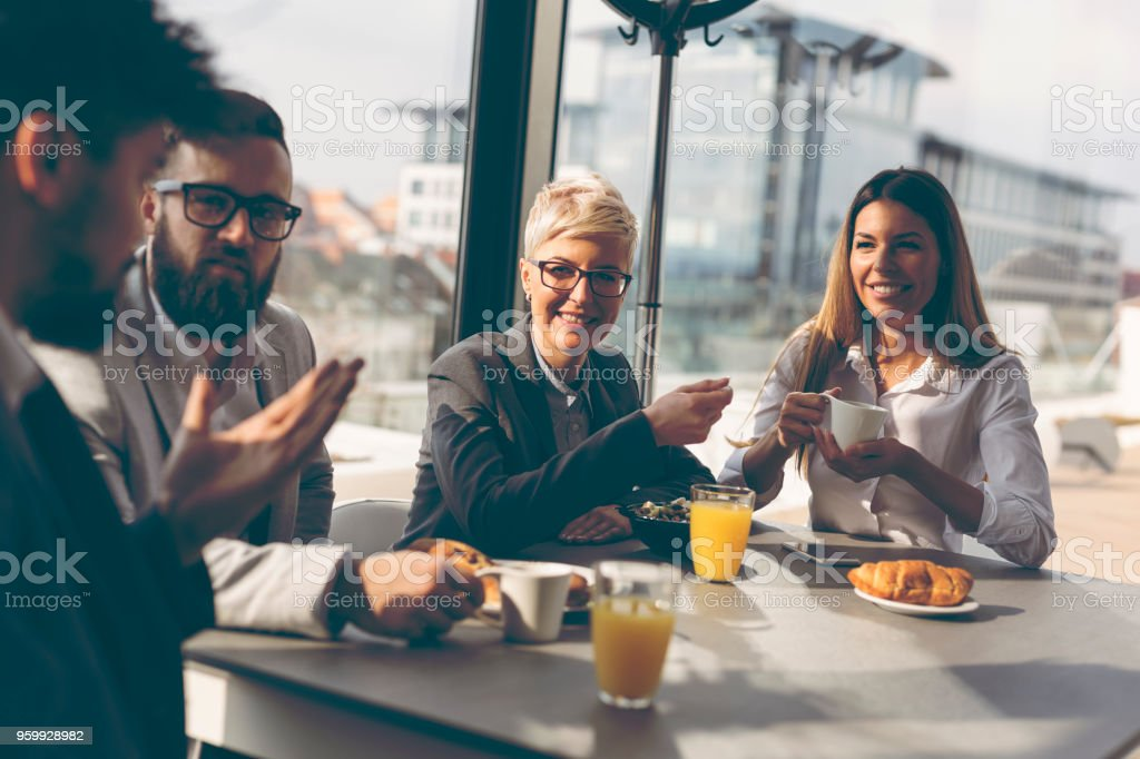 Business people having breakfast stock photo