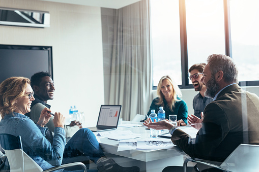 istock Business people having casual discussion during meeting 861164910