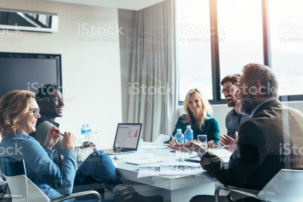 Business people having casual discussion during meeting stock photo