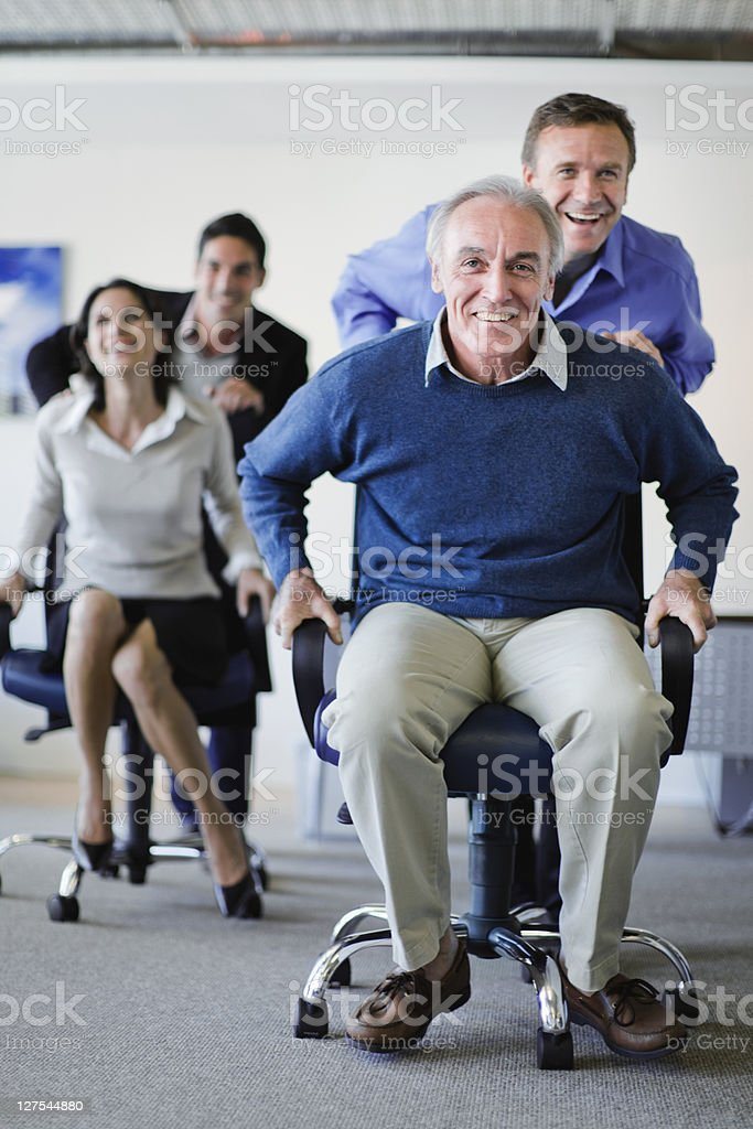 Business people having chair race stock photo