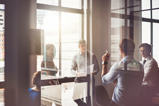 istock Business people having discussion in board room 627419088