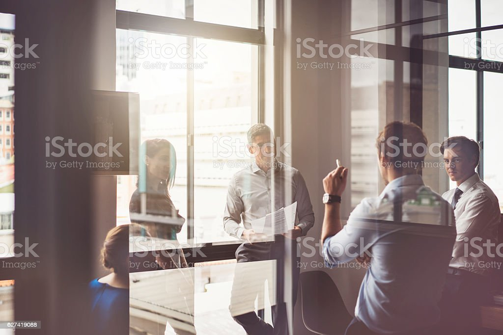 Business people having discussion in board room stock photo