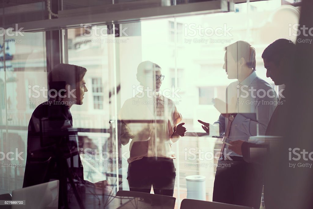 A photo of business people discussing in meeting room. Businesswoman...