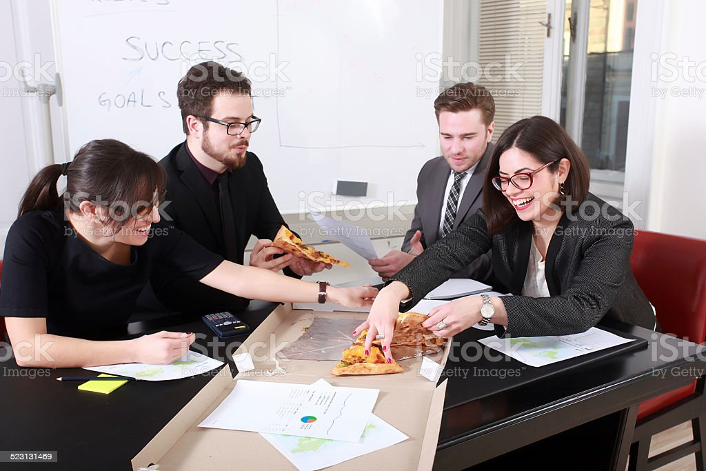 Business people having meal together stock photo