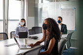 istock Business people having meeting during pandemic 1264980571