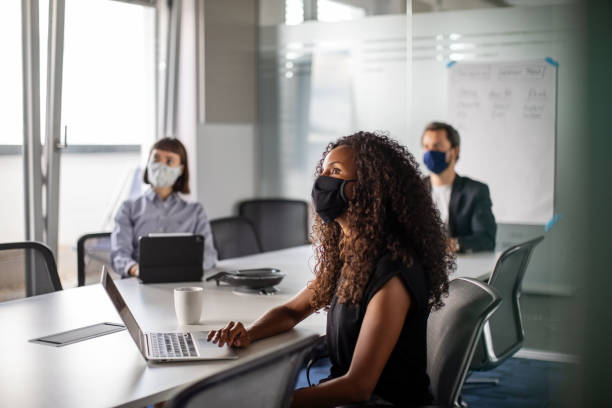 business people having meeting during pandemic - social distancing stock pictures, royalty-free photos & images
