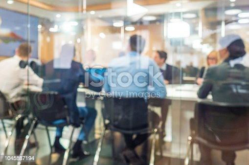 Businessmen and businesswomen having meeting in board room.