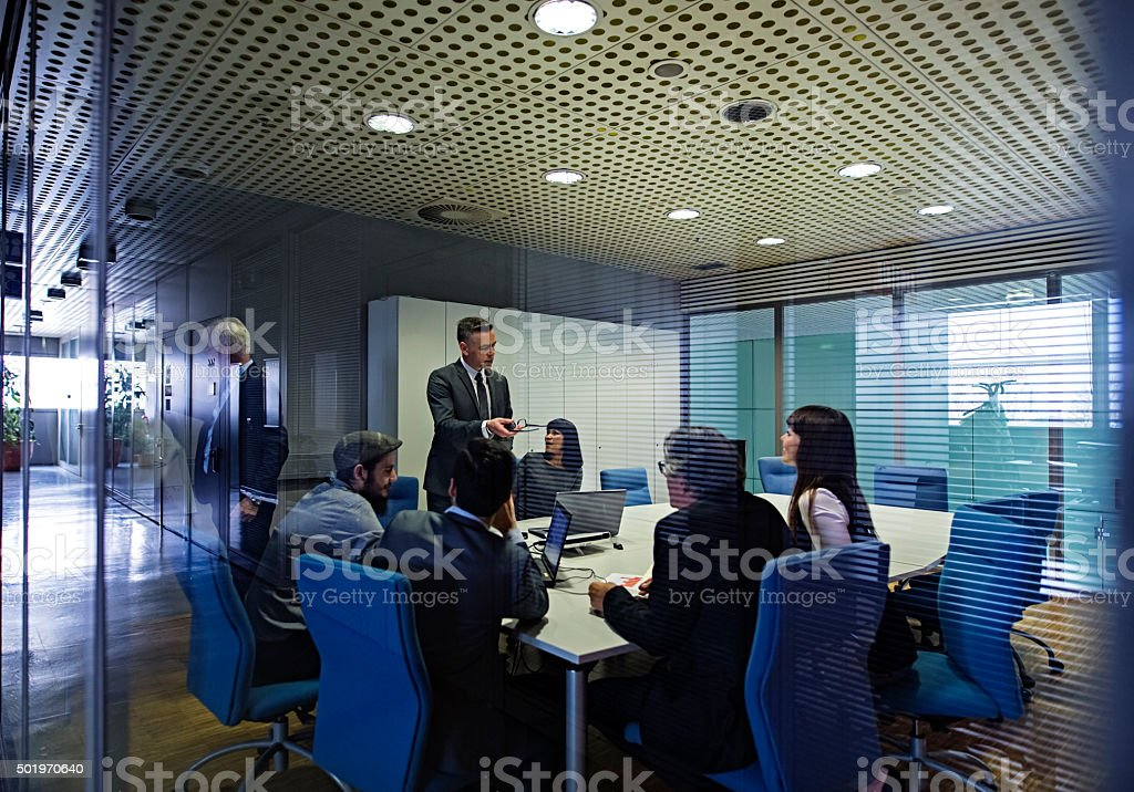 Business people having meeting in conference room stock photo