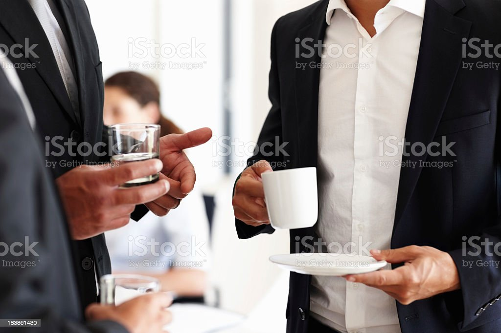 Business people having water and coffee stock photo