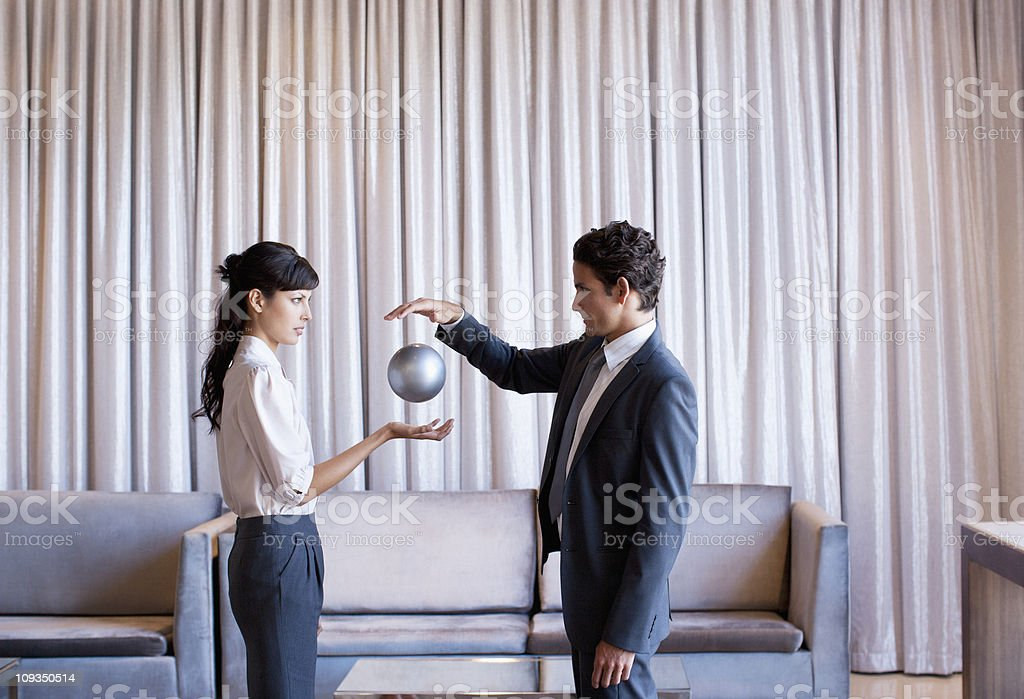 Business people high-fiving in hotel lobby stock photo