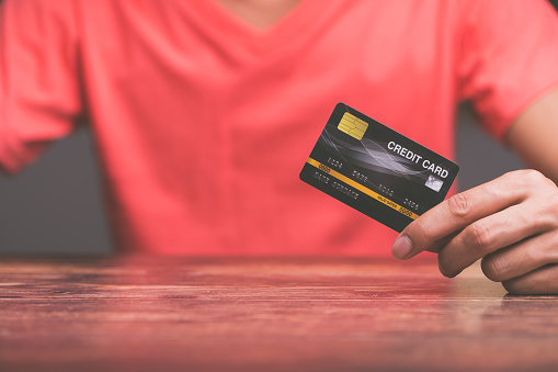 Business people hold credit cards
