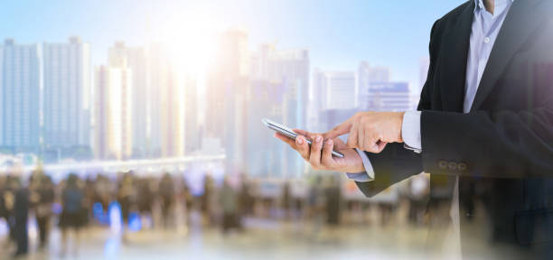 Business people hold smartphones using communication technology stock photo