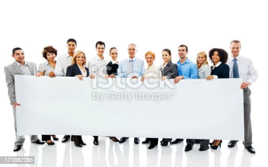 Successful happy business people holding a banner and looking at camera. Isolated on white.