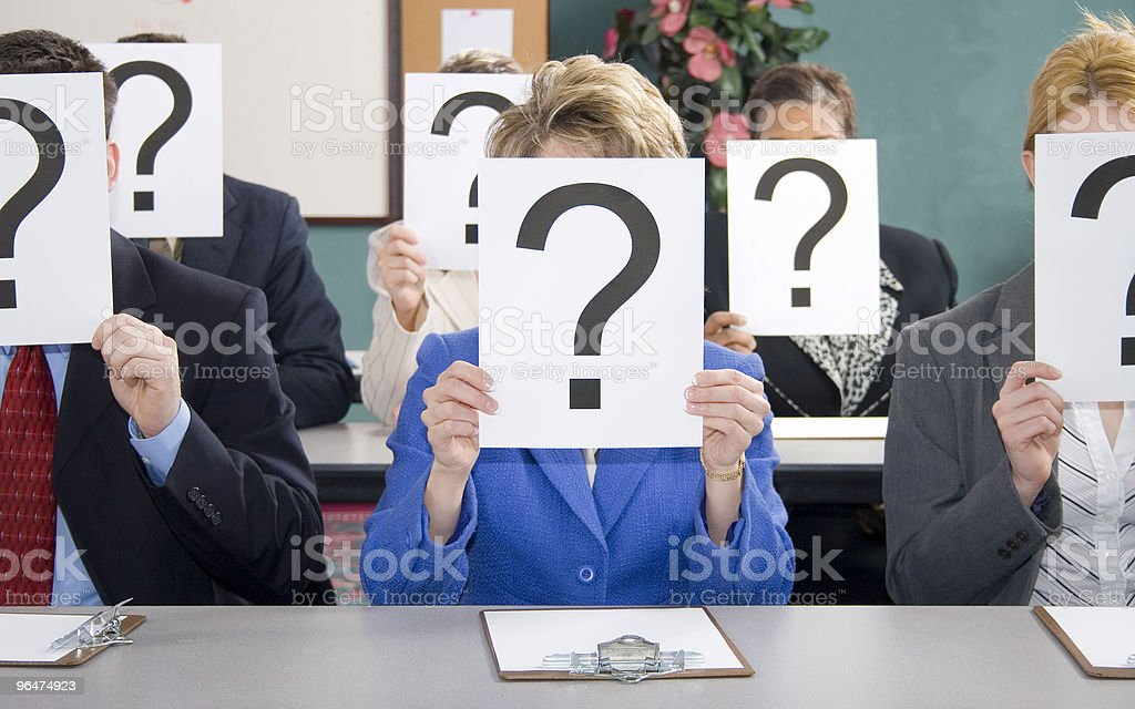 Business people holding a question mark on paper royalty-free stock photo