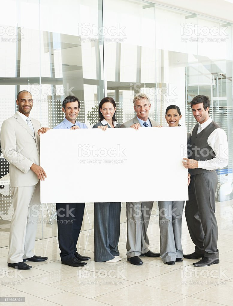 Business people holding blank bill board royalty-free stock photo