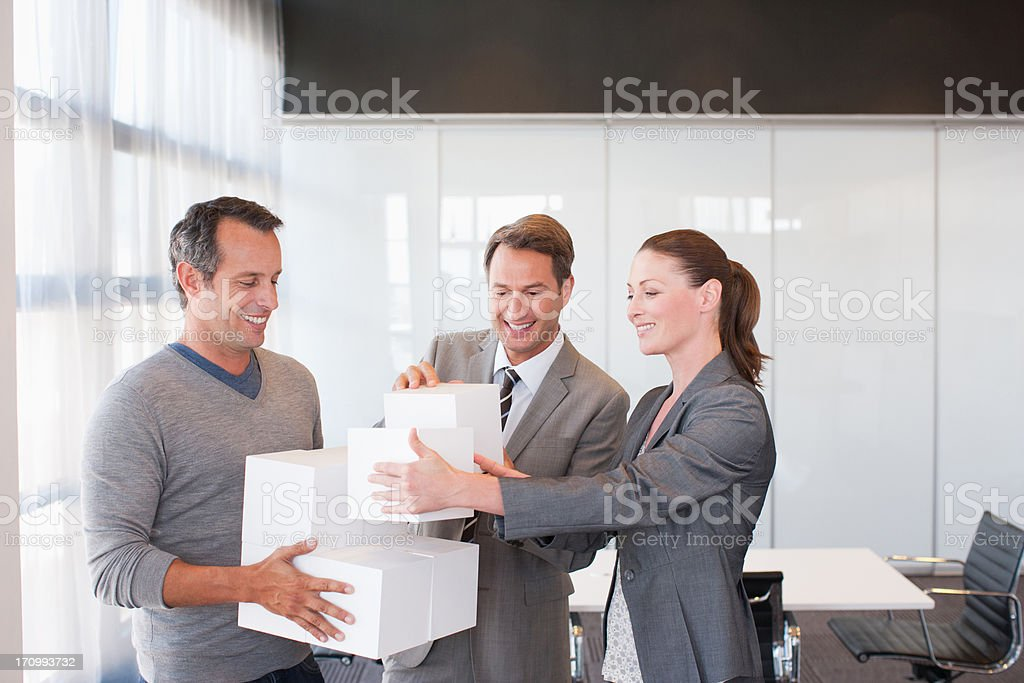 Business people holding cubes stock photo